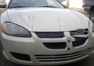 a wrecked Dodge Avenger before Murphy Bros. Auto Body