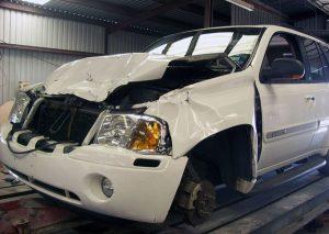 a wrecked GMC Envoy before Murphy Bros. Auto Body